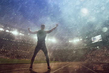 Image of muscle man posing on stadium