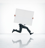 Businessman holding blank poster and running fast