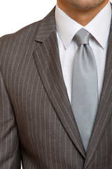 grey suit with grey tie
