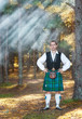 Handsome scottish man in the forest