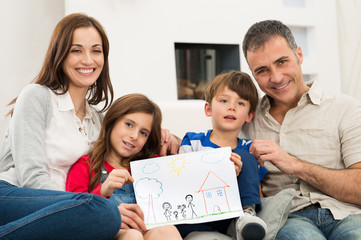 Family with new house drawing