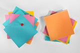 Pile of blank colorful paper notes with pin on white background.