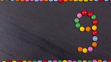 Coloured candy chocolate countdown stop motion background