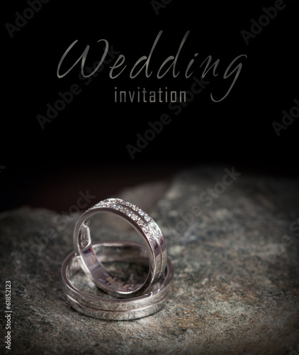 Two silver wedding rings on rock