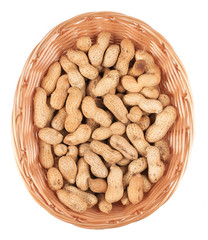 Basket full with peanuts.