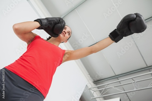canvas print picture Determined female boxer focused on training at gym