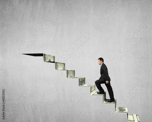 Walking on money stairs to top