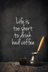 Coffee on blackboard background with text