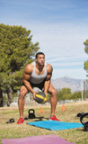 Male Exercising with Medicine Ball