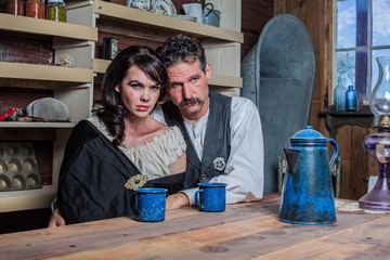 Serious Western Sheriff and Woman Pose Inside House