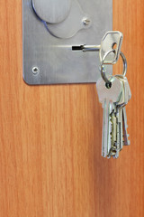 bunch of keys in keyhole of door