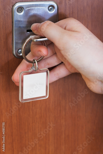 opening house door by key with blank keychain