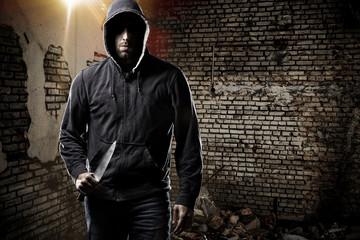 Thief in a dark alley