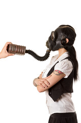 Girl in a gas mask. helping hand