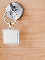 one key with blank square keychain in lock