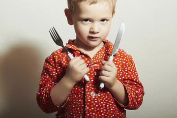 Little Handsome Boy with Fork and Knife.Hungry Child.Food