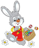 Little rabbit walking with a basket of Easter eggs