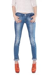 Shapely female legs dressed in blue jeans
