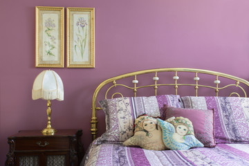 Lavender bedroom interior with brass headboard