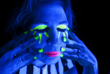 Woman black light eyes closed hands on face poster
