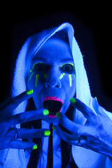 Woman black light towel scream