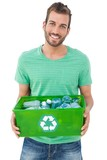 Portrait of a smiling man carrying recycle container