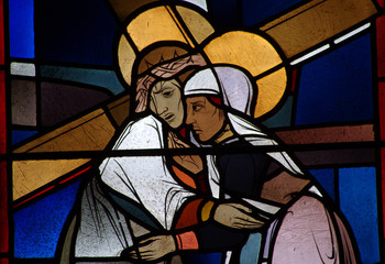 Jesus carrying the cross meets his mother Mary. Stained glass