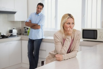 Couple not talking after an argument in kitchen