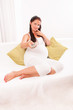 Beautiful pregnant woman sitting on the couch
