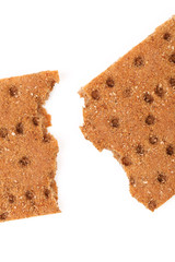 Broken whole grain crisp bread.