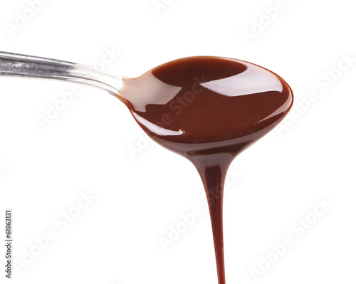 Liquid chocolate on a spoon.