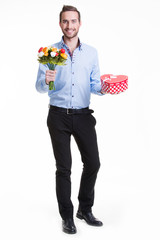 Happy young man with flowers a gift.