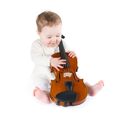 Funny little baby playing violin