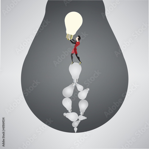 Сoncept - a man stands on the old bulbs ( ideas )