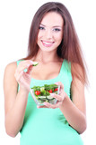 Beautiful girl with fresh salad isolated on white