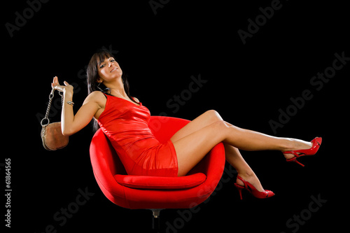 Fashion baby on red chair