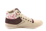 Fashion sneaker with flower closeup.