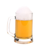 Mug of fresh beer with foam.