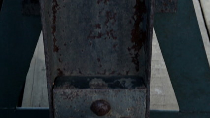Close image of the steel bolt in the beam rusty big metal stand