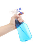 Hand holding blue plastic spray bottle.