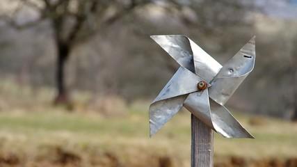 Homemade pinwheel of sheet metal is ugly and dysfunctional