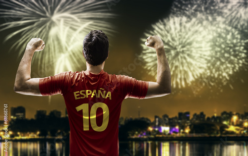 Spanish fan celebrates the victory after the match