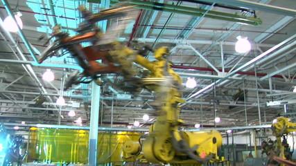 Robotic Arm Swings Car Door Frame Around To Be Welded