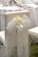 Detail of a chair decorated for a wedding reception