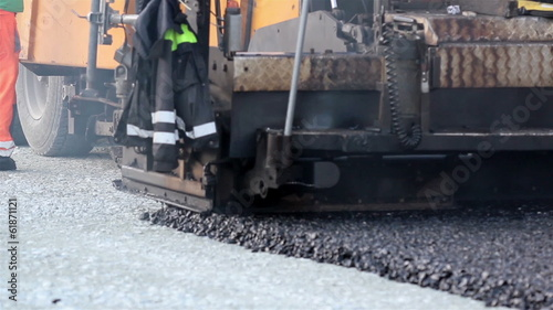 Asphalt paver applying asphalt on the highway