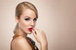 canvas print picture - Beautiful blonde with red lipstick posing in the studio