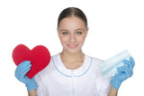 Smiling female doctor shows heart symbol