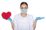 Doctor woman in mask weighs on hand heart