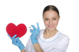 Smiling nurse with a syringe prick heart symbol
