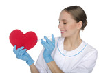 Female doctor with a syringe pricks  heart symbol